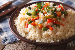 Arabic cuisine: couscous with vegetables close-up. horizontal Royalty Free Stock Images