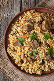 Arabic cuisine national rice food called pilaf. Traditional arabic cuisine national rice food called pilaf with fried lamb meat, onion, carrot and garlic spice Royalty Free Stock Photo