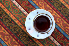 Arabic cup of tea. On a table Royalty Free Stock Photo