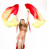 Arabic dance with fans and ribbons performed by a beautiful plump woman.  Royalty Free Stock Images