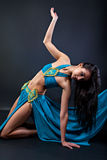 Arabic dance performed by a beautiful brunette Royalty Free Stock Photos