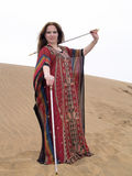 Arabic dancer with batons and robe Royalty Free Stock Photo