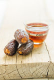 Arabic dates and coffee mug Royalty Free Stock Photos
