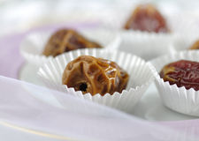 Arabic dates in paper cup. Extreme close up of arabic dates in paper cups Royalty Free Stock Photo
