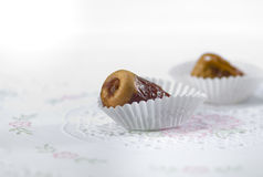 Arabic dates in paper cup. Extreme close up of arabic dates in paper cups Stock Photo