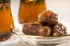 Arabic dates and tea stock photos