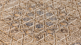 Arabic decoration on acient wall. Alhambra in Granada, Spain. Detail of a 800 years old wall in islamic style Stock Images
