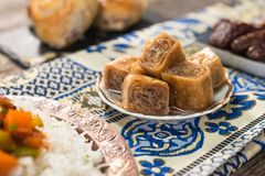 Arabic dessert baklava. On plate Royalty Free Stock Photo