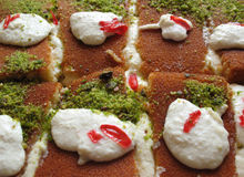 Arabic Dessert Plate. A plate of cream-filled Arabic sweet pastries called Knefeh Stock Photo
