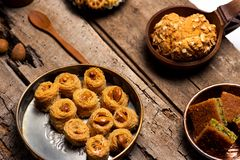Arabic desserts in rustic bowls top view stock images