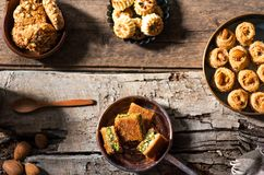 Arabic desserts in rustic bowls top view stock photos
