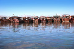 Arabic dhow. A row of arabic traditional, wooden boats Royalty Free Stock Photography