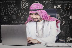 Arabic doctor uses laptop in laboratory Royalty Free Stock Photo