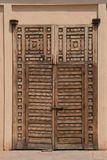 Arabic door. Intricate rustic Moroccan wooden door Royalty Free Stock Photo