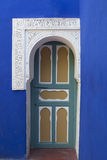 Arabic door 2. Door of an ancient building in the city of Marrakech; the characteristic shape of the arc Royalty Free Stock Image
