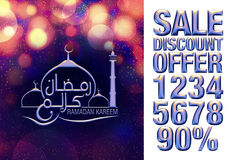 Arabic and English Islamic calligraphy text Ramadan Kareem with mosque on shiny abstract background. Stock Photos