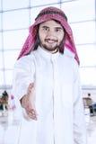 Arabic entrepreneur offering handshake in airport Stock Photos