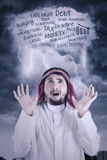 Arabic entrepreneur surprised with cloud speech Royalty Free Stock Image