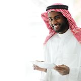 Arabic executive person using tablet Stock Photography
