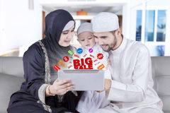 Arabic family browsing promo online stock photo