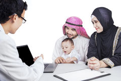 Arabic family and doctor look at laptop Royalty Free Stock Images
