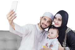 Arabic family taking selfie picture royalty free stock image