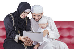 Arabic family use table on sofa Royalty Free Stock Image
