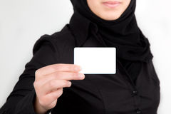 Arabic female hand holding the white businesscard Stock Photos