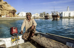 Arabic ferry man transports passenger in an old traditional boat Stock Image