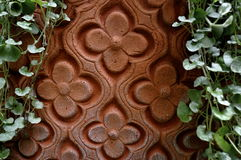 Arabic floral design in clay Stock Photos