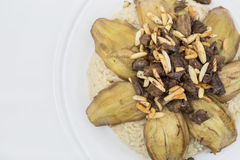 Arabic food, Content : eggplant, rice, meat, it`s name in Arabic Makloba Stock Photos