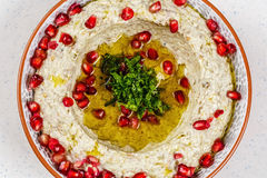 Arabic food Hummus with pomegranate. In a traditional bowl Royalty Free Stock Image