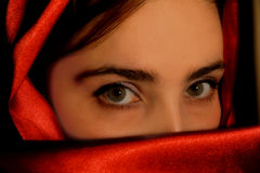 Arabic girl. A portrait of a young arabic woman in red satin Royalty Free Stock Image