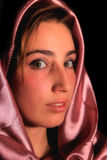Arabic girl. A portrait of a young arabic woman in red satin Stock Photo