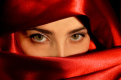 Arabic girl. A portrait of a young arabic woman in red satin Stock Photos