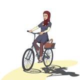 Arabic girl riding bicyle Stock Photos