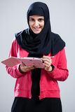Arabic girl with a tablet. View of arabic girl with a tablet Stock Photography