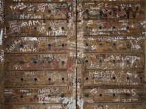 Arabic Graffiti. Graffiti is scribbled in Arabic on a wooden door in Lebanon Stock Photos
