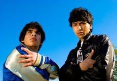 Arabic guy. Two arabian guys portrait over blue sky background Stock Photo