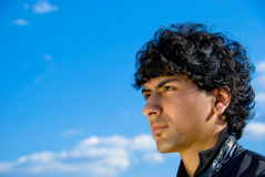 Arabic guy. Arabian guy portrait over blue sky background Stock Photography