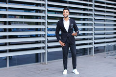 Arabic guy in business center stands smiling Royalty Free Stock Photos