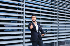 Arabic guy in business center stands smiling Stock Image