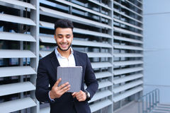 Arabic guy in business center stands smiling Stock Photography