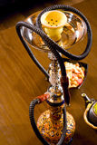 Arabic hookah with woman's reflection stock photo