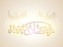 Arabic Islamic Calligraphy for Ramadan Kareem. Glossy Arabic Islamic Calligraphy of text Ramadan Kareem on Mosque silhouetted background