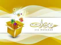 Arabic Islamic calligraphy of text EId Mubarak. With gift boxes, beautiful shiny background. EPS 10 Stock Photos