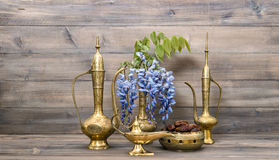 Arabic jug vase lamp tea pot. Fruits and flowers Food and drink. Arabic jug, vase, lamp, tea pot. Fruits and flowers. Golden oriental decorations. Food and drink Royalty Free Stock Image