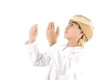 Arabic kid praying isolated stock image