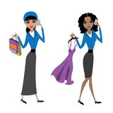 Arabic  lady with  shopping bags and afrrican american woman wit Royalty Free Stock Image