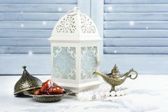 Arabic lantern, dates, aladdin lamp and rosary on white background. Ramadan kareem greeting card. Copy space royalty free stock photo